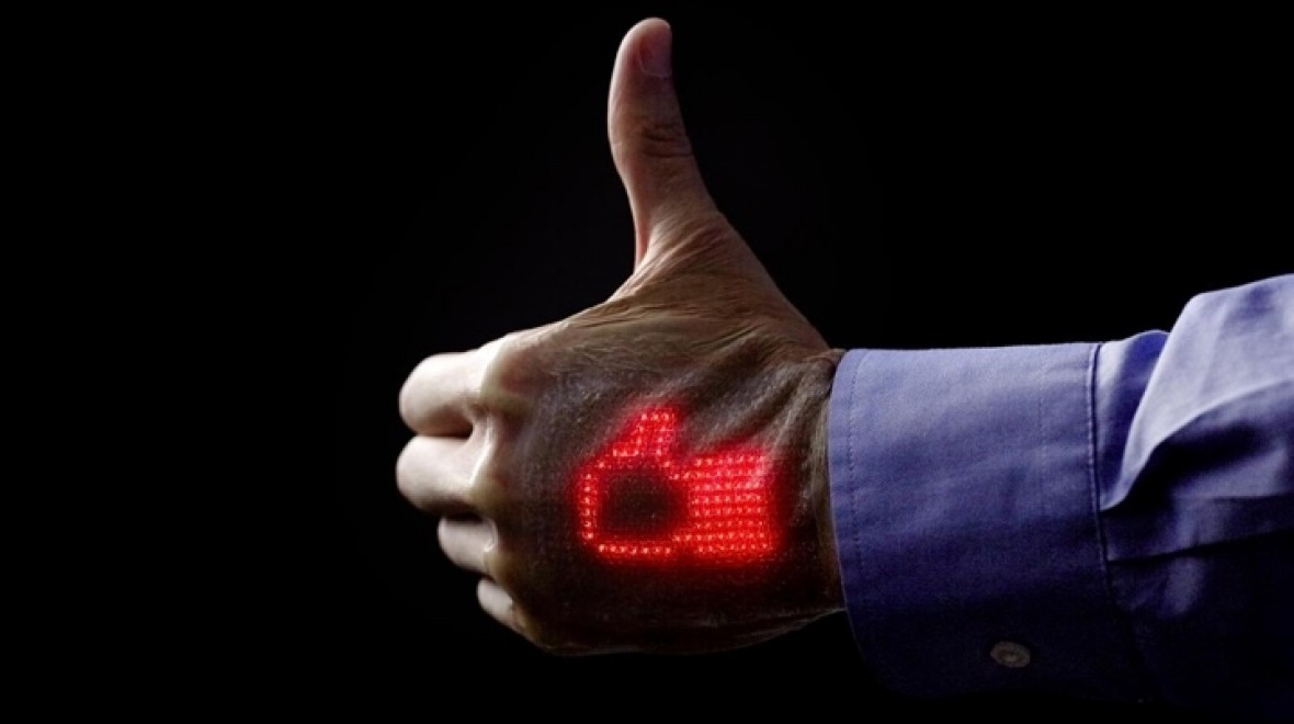 Electronic skin patch shows off vitals