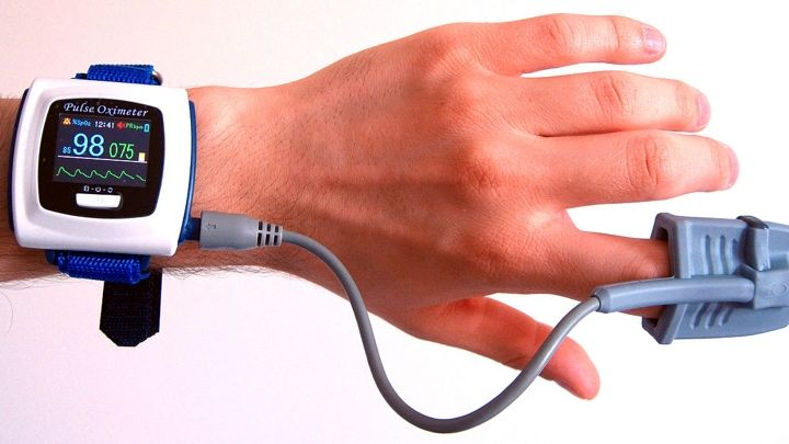 An early pulse oximeter worn on the finger